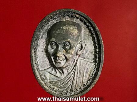 B.E.2535 LP Kasem silver amulet in oval shape (MON124)