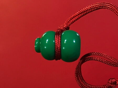 B.E.2527 bottle gourd or Nam Taow amulet in green color (TAK36)